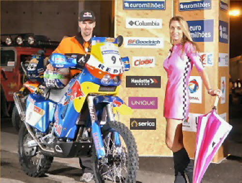 Chris at the start of the Dakar Rally with Anne Grider in pink